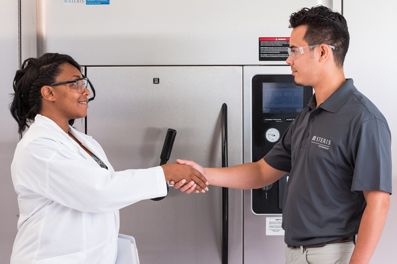 STERIS Employee and Customer Shaking Hands